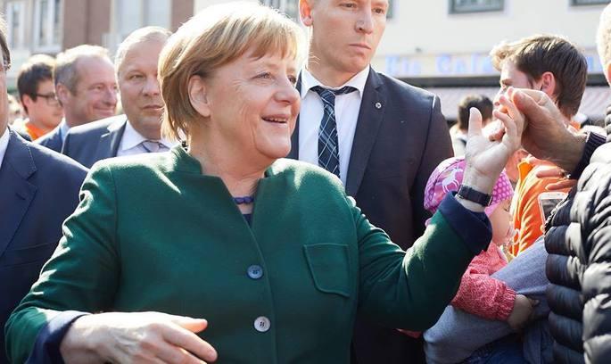 На регіональних виборах, важливих для всієї Німеччини, перемагає Меркель