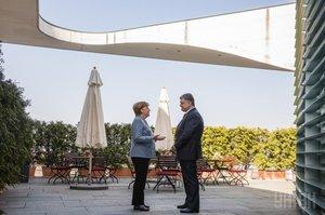 Меркель підтримує Порошенка і про стосунки з РФ не забуває