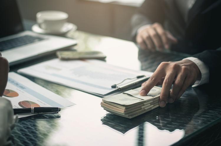Нацкомісія з цінних паперів зобов'язала звітувати про позабіржові угоди